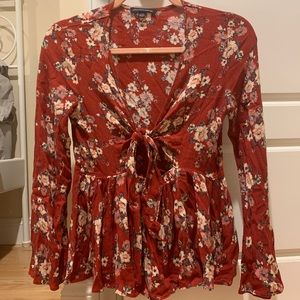 Floral peplum tie front blouse with bell sleeves